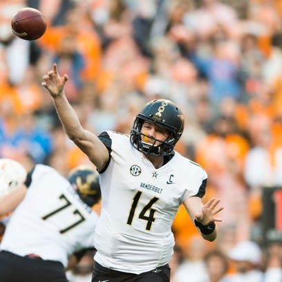 Vanderbilt quarterback Kyle Shurmur (14) throws the