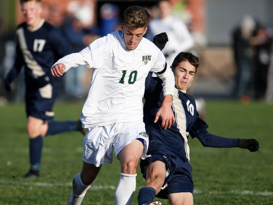 Vestal's Parker McKnight is slide tackled by Sutherland's
