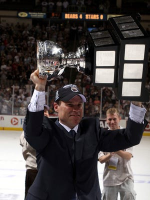 In a photo provided by the American Hockey League, then-Hershey Bears assistant coach Troy Mann celebrates the team's Calder Cup championship on June 14, 2010, in Hershey, Pa. Mann beamed with pride when more than a half-dozen players he coached with the Bears contributed to the victory that got the Capitals into the Eastern Conference final. Many of those players are still playing key roles for Washington in the Stanley Cup Final against the Vegas Golden Knights--more than a month after Mann was fired from his job as Hershey's head coach. ( JustSports Photography/AHL via AP)