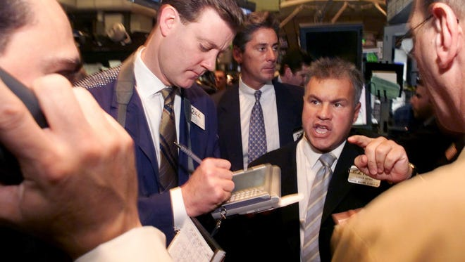 Louis Spina, second from right, conducts trading in shares of Kohl's Corp. on the floor of the New York Stock Exchange in 2001. Spina was a Wall Street whiz but a self-described 'fool with money' who is now on jail on federal wire fraud charges.