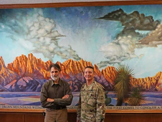 Artist Robert Glaisek poses in front of his mural with Brigadier General Eric Sanchez, current commander of White Sands. Sanchez told Glaisek that his father was an artist, so he appreciated the talent and work that went into the painting.