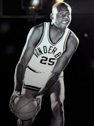 """A poster of former Vanderbilt basketball player Perry Wallace hangs on a wall at the Nashville premiere of the documentary movie """"Triumph: The Untold Story of Perry Wallace,"""" chronicling the 50th anniversary of the integration of SEC basketball, on Monday, Dec. 4, 2017, in Nashville, Tenn. Perry Wallace, the first black basketball player at Vanderbilt University and the subject of the documentary movie, died Dec. 1."""
