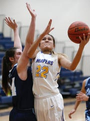 Eastwood's Kaylee Martinez takes the ball to the basket against Chapin forward Angie Enriquez during action in their game Friday morning during the second day of action in the McDonald's Classic Basketball Tournament being played at Del Valle High School. The Troopers went on to win the contest 47-31.