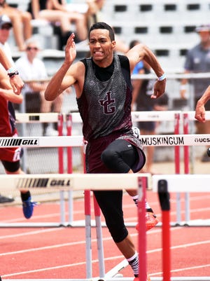 John Glenn's Joseph Clifford runs the 110 high hurdles during a Division II regional track meet last season. Clifford signed to run track for Nebraska on Friday.