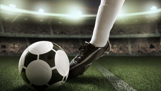 STOCK IMAGE: Soccer player in stadium