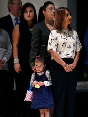 Olivia Roddy, 3, stands with her mother, Amanda Median-Roddy,