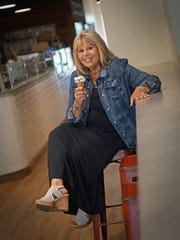 Lisa McInnis eats ice cream at the UD Creamery on Market Street wearing a black skirt by LuLaRoe; jean jacket by A.M.I.; and beige crochet cork platform shoes by JellyPop.