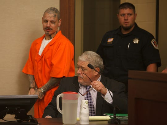 Mario Antoine Lucero enter the courtroom and moves to sit next to his attorney Edward Flint during Lucero's preliminary hearing on charges of first-degree felony murder and third-degree felony assault in 5th District Court on Sept. 18, 2014.