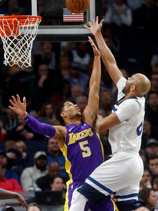 Minnesota Timberwolves' Taj Gibson shoots over Los Angeles Lakers' Josh Hart during the second half of an NBA basketball game Thursday, Feb. 15, 2018, in Minneapolis. The Timberwolves won 119-111. (AP Photo/Jim Mone)