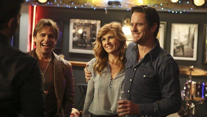 "Scott Reeves, Connie Britton and Charles Esten work on the set of ""Nashville."""