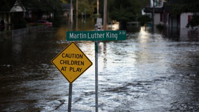 Floodwaters caused by rain from Hurricane Matthew cover Martin Luther King Jr. Drive in Lumberton, N.C., on Oct. 10, 2016.