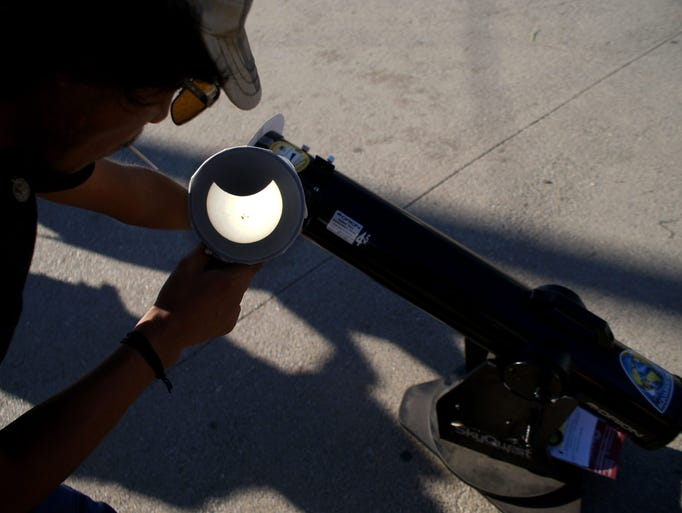 A man observes a partial Solar eclipse in Ensenada,