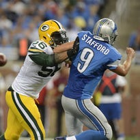 Green Bay Packers linebacker Julius Peppers (56) pressures Detroit Lions quarterback Matthew Stafford (9) in the third quarter at Ford Field in Detroit.