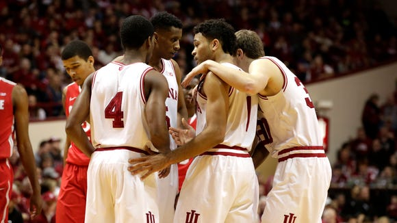 Indiana players huddle before free-throw shots during a NCAA men's basketball game on Saturday, Jan. 10, 2015, at Assembly Hall in Bloomington.