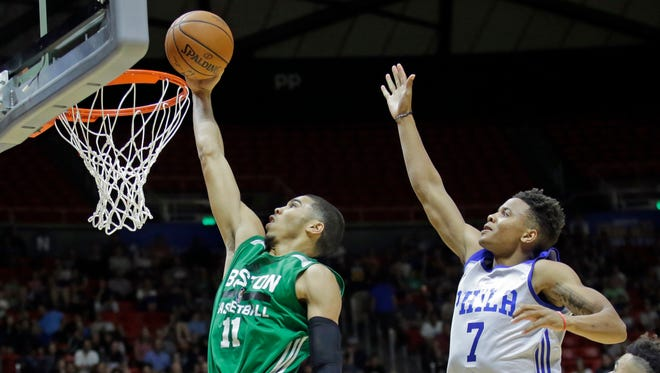 Boston Celtics forward Jayson Tatum (11) lays the ball in as Philadelphia 76ers guard Markelle Fultz (7) defends during the second half of an NBA summer league game.