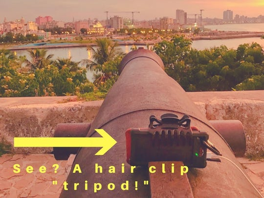 Here's a tripod I made using my phone, the portable solar battery charger that went with me everywhere in Cuba, and my hair clip. It's sitting on top of a 17th Century Cannon in Fort Havana.