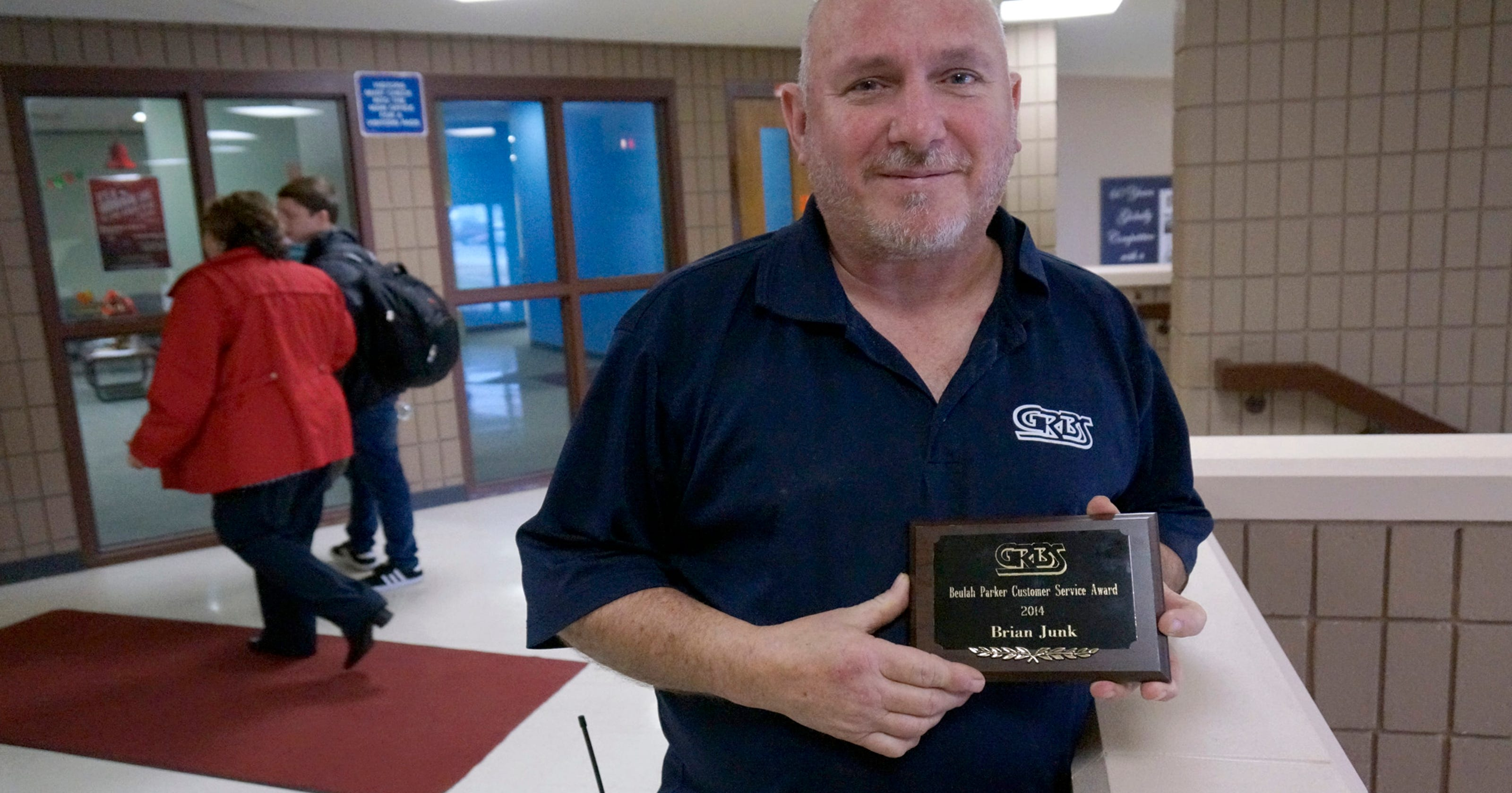 Custodian brian junk honored for customer service for Garden of life customer service