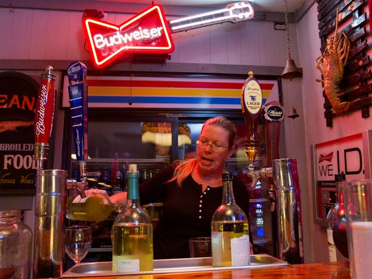 Jody Jones, general manager at the Crackerbox in south Fort Myers, prepares a few drinks for customers.