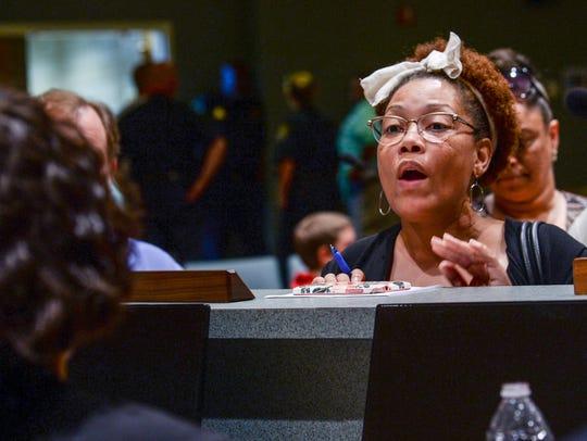 Tonya Winbush of Anderson, right, talks to City Councilwoman