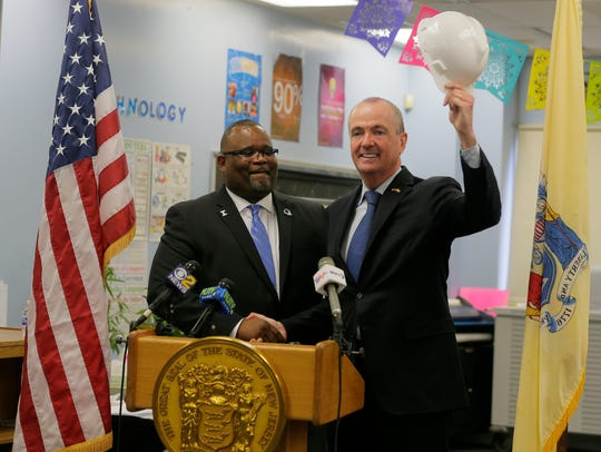 Lamont Repollet introduces Gov.-elect Phil Murphy to