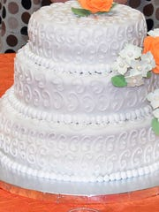 McComb's Ariana Harrison designed a fall wedding cake for JCJC's culinary arts class's Cake Show.