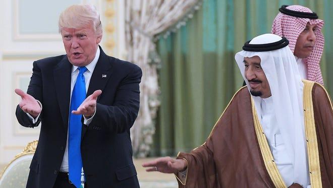 In this file photo taken on May 20, 2017, President Donald Trump  and Saudi Arabia's King Salman bin Abdulaziz al-Saud attend a signing ceremony at the Saudi Royal Court in Riyadh.