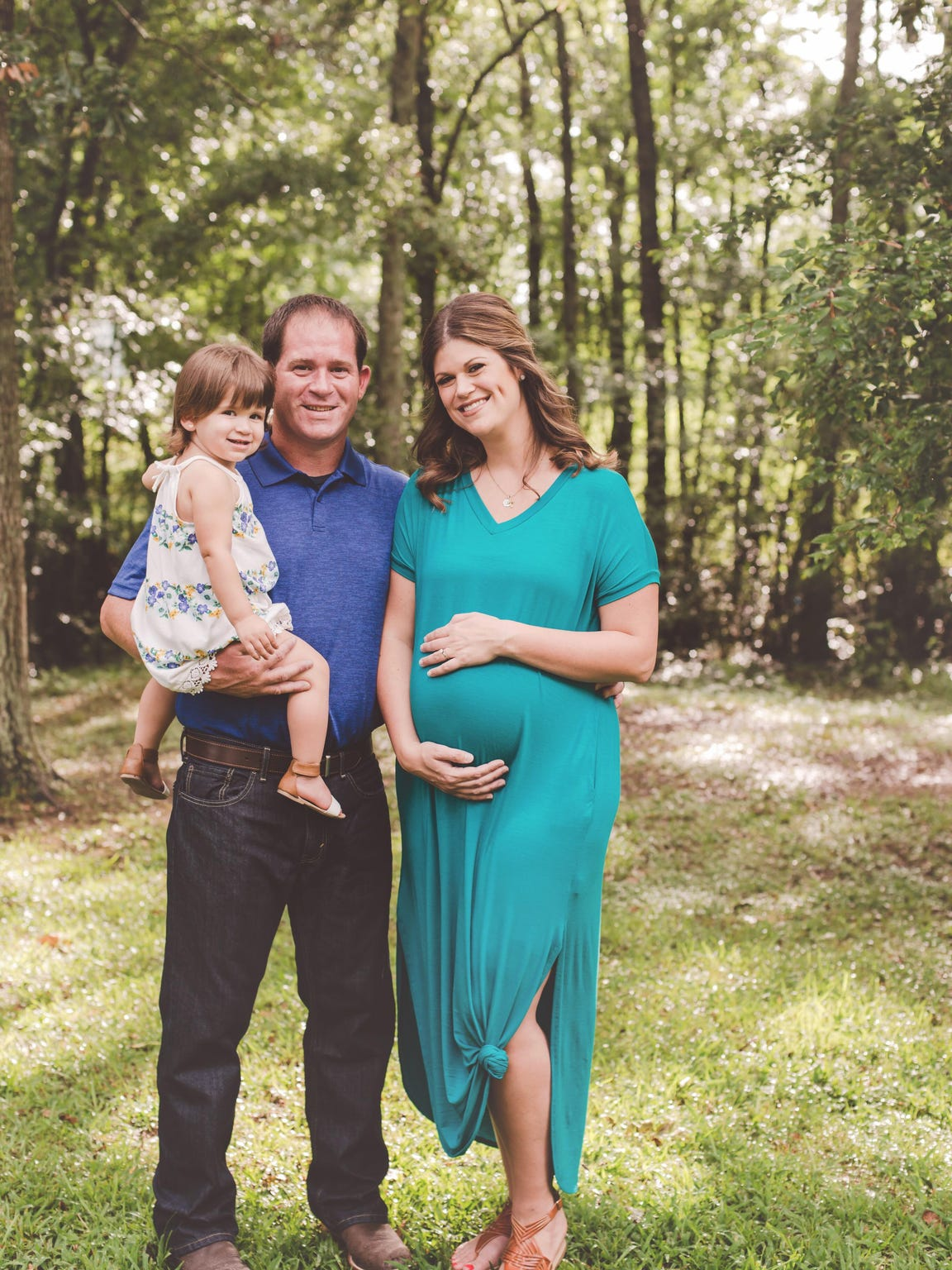 The Decell family poses for a maternity shot.