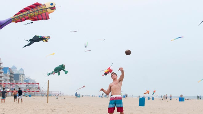 Instead of sticking to your beach towel, toss a football around to burn some calories while you're enjoying the sun and sand.