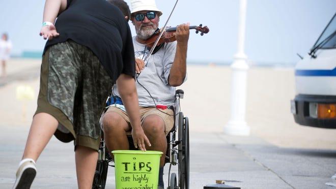 Lucian Ionescu plays his violin on the Ocean City Boardwalk.