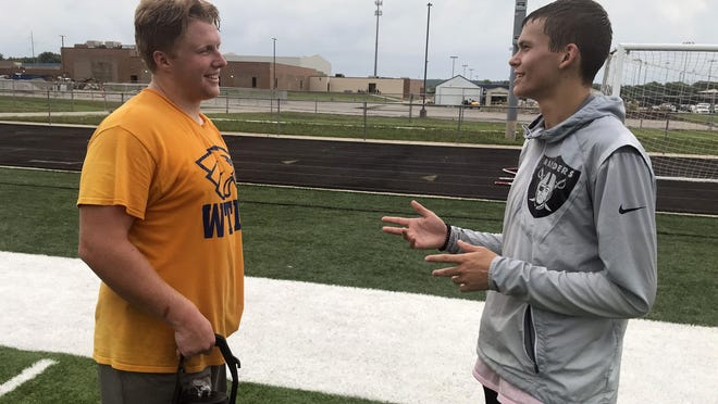 Grain Valley senior offensive lineman Jack Bailey, left, talks with a fellow senior, wide receiver/cornerback Trent Knox, after an OTA (organized team activity) at Moody Murry Field on an overcast Tuesday morning.