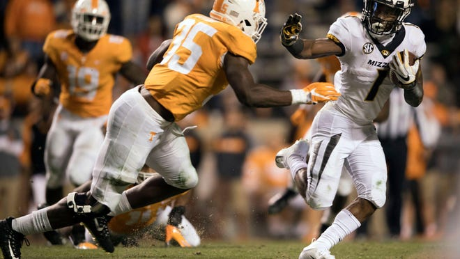 Missouri running back Tyler Badie (1) is pursued by Tennessee linebacker Daniel Bituli (35) during a game Nov. 17, 2018, in Knoxville, Tenn.