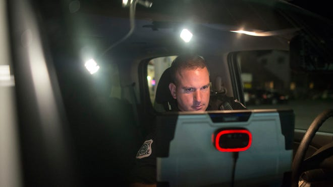 """Sgt. Cliff Dempsey patrols Dewey Beach late Thursday night, July 17. """"A lot of our night is just driving up and down this 1-mile stretch,"""" the officer says of Route 1."""