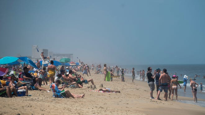 Beach goers in Dewey Beach enjoy the nice weather before tropical storm Arthur is expected to come through.