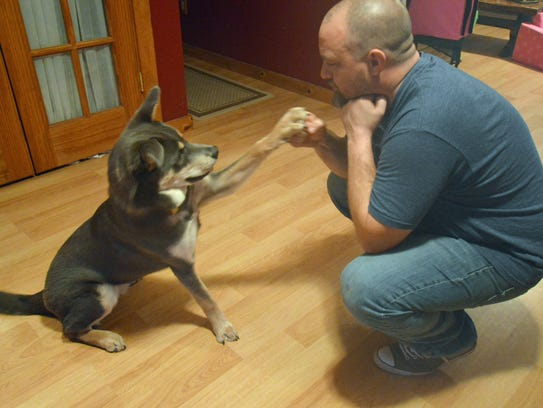Bob Meyer doing a high-five with Homer, whom he adopted