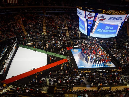 Wrestlers stand on the matt during the Parade of Champions