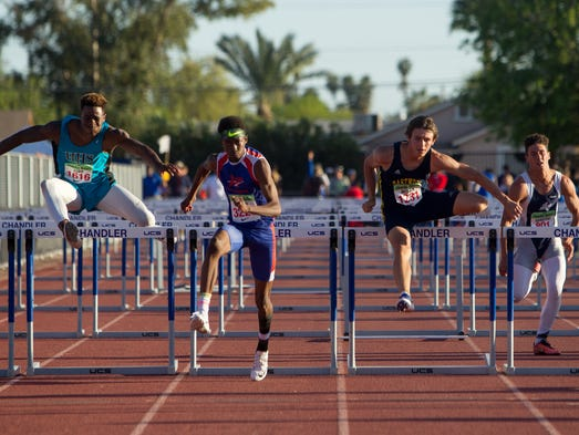 High school student complete the 110M high hurdles