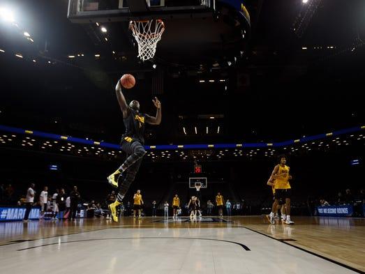 Iowa's Peter Jok dunks during Iowa's practice at the