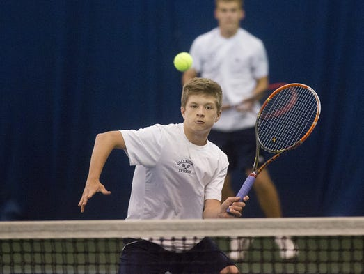 Dallastown's Holden Koons hits a return at the net.