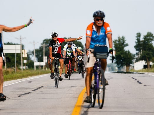 RAGBRAI riders signal a turn as they wrap up the Karras