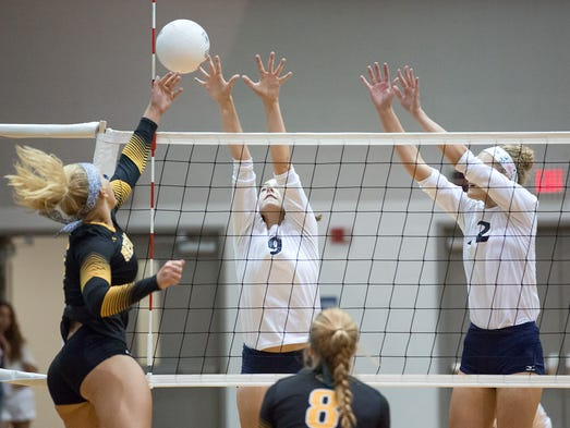 Red Lion's Lindsey Blevins taps the ball past Dallastown's