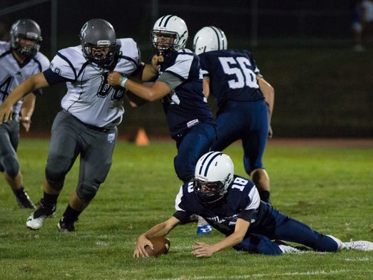 West York quarterback Corey Wise recovers his fumble