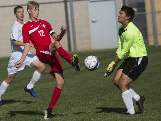 Susquehannock's Colton Mumley, left, has his shot stopped