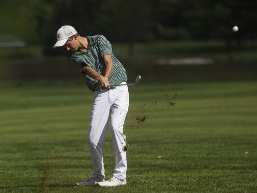 York Catholic's Andrew Forjan hits his ball. Golfers