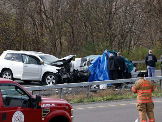 Police investigate a fatal car crash on State Route
