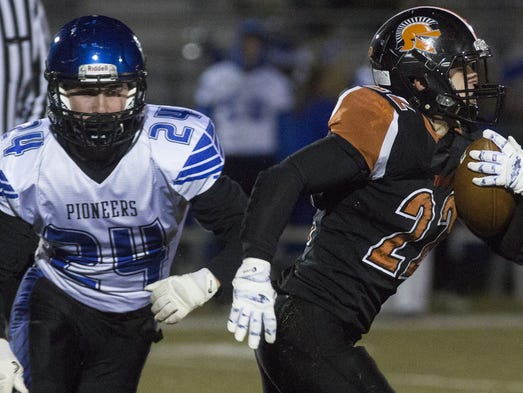 Lampeter-Strasburg's Marc Wilson, left, pursues York