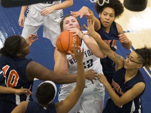 West York's Paige Weekly, center, scores and draws