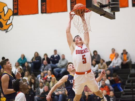 Northeastern's Antonio Rizzuto misses a dunk as Northeastern
