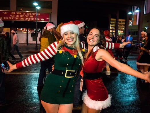 Cassie Edwards and Emily Santhop look for holiday cheer