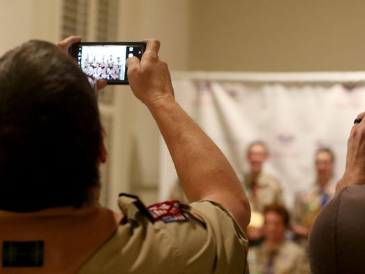Parents take pictures of the new Eagle Scouts at the