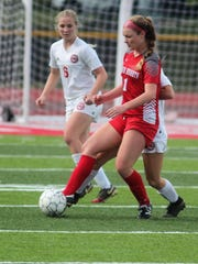 Dixie Heights sophomore Carson Smith controls the ball